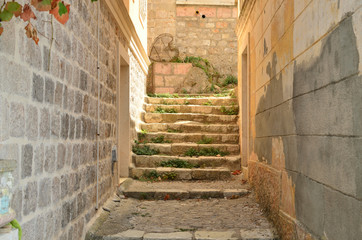 Old stone staircase in a small coastal village alley