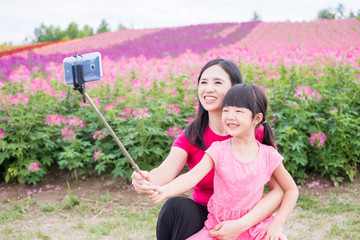 mother and daughter selfie happily