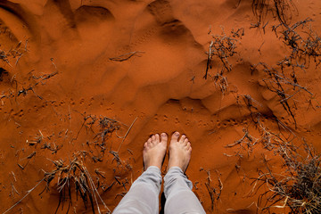 Woman feet in the red australian sand. Nothern Territory, Australia.