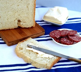 Sandwiches with sausage and butter on white wheat bread