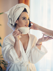 Young woman enjoying coffee at home. Morning coffee daily routine.
