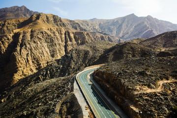 Jabal Jais mountain range and scenic road through the dessert