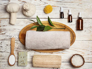 Beautiful composition with spa cosmetics and accessories on wooden background
