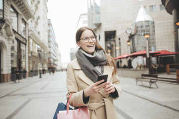 Cheerful woman doing shopping