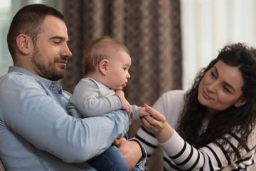 Family With New Baby Happy on the Couch