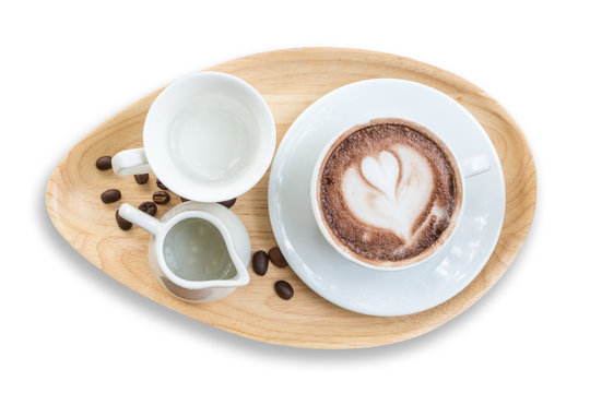 Top view of hot latte coffee in white cup. Isolated on white. Saved with clipping path