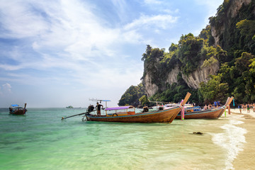 View to the famous Monkey Beach with longtail boats and tourists, on Phi Phi Don island, Phi Phi Islands, Krabi Thailand