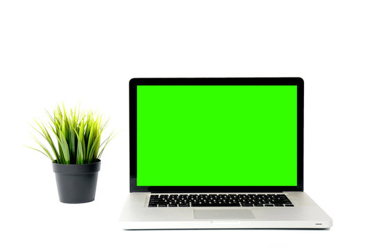 Mockup image of laptop with blank green screen.
