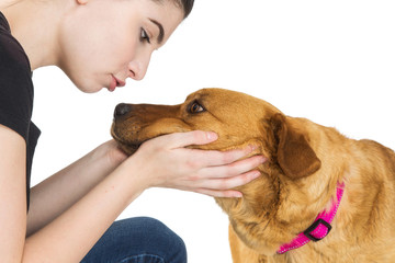 Pretty Young Woman Caressing Face of Dog