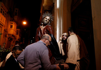 A statue of Jesus Christ is carried after a Good Friday procession in Valletta