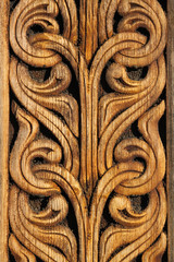 Norwegian viking  wooden knot work on the side of a building