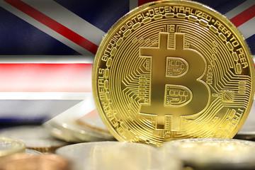 golden bitcoins on UK flag background