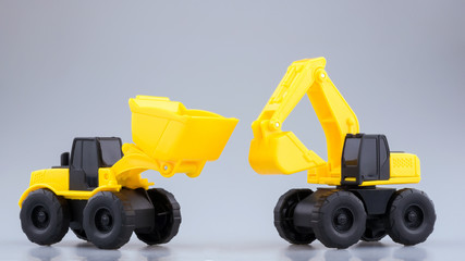 Heavy duty construction backhoe and Tractor toy on clear background.