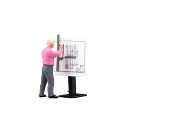 Miniature engineering people working on construction drawing isolated with clipping path on white background. Elegant Design for industrial and construction concept.