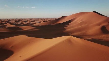 Wall Mural - Aerial view on big sand dunes in Sahara desert at sunrise, Africa, 4k