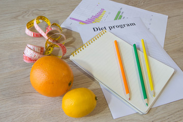 Healthy natural organic food diet, ripe harvest. Fruit composition, measuring tape, calculator with diet plan