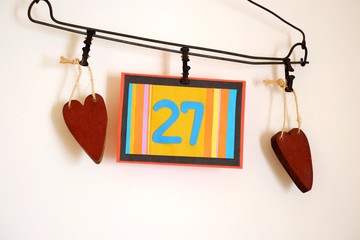 Number 27 anniversary celebration card against a bright white background