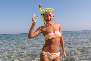 Cheerful woman wearing snorkeling mask