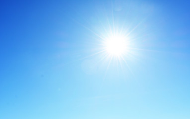 bright white sun on a blue sky.beautiful natural landscape, background