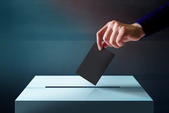 Hand Dropping a Ballot Card into the Vote Box, Polish and Dark Tone