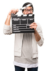 Hipster man holding a clapperboard on white background