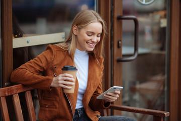 Joyful female person typing message