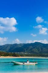White sand beach crystal clear turquoise water at Kabira Bay, Ishigaki, Okinawa