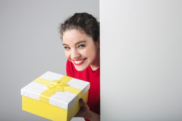Smiling woman holding a present