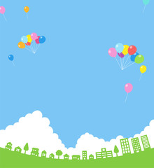 入道雲の青空と風船と街並み|背景素材