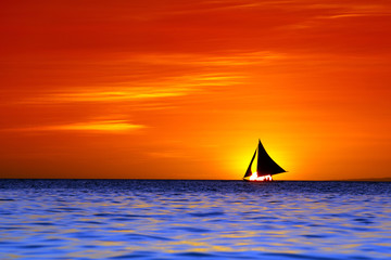 Sailing and beautiful red sunset at Boracay Island, Philippines