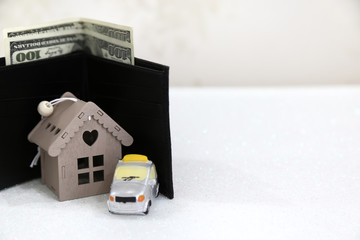 Real estate and mortgage invesment. A wooden gift house and car on the white background with bubbles