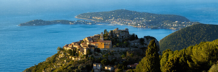 The Village of Eze (Èze), the Mediterranean Sea and Saint-Jean-Cap-Ferrat at sunrise. Alpes-Maritimes, French Riviera, Cote d'Azur, France