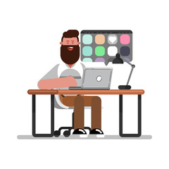 Man designer searching for references on laptop