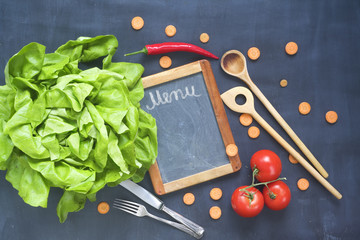 Food ingredients, kitchen utensils,black board for menu, top view, copy space