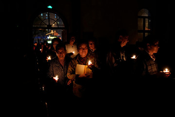 Chinese Catholics attend the Easter Vigil at a Catholic church in Shanghai