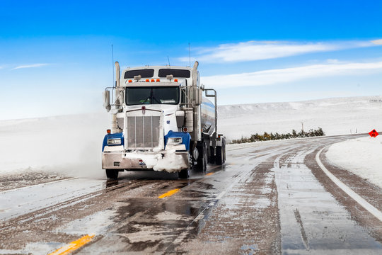 big truck drives on a snowy road
