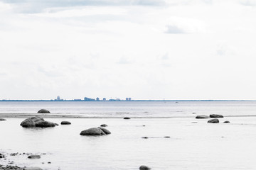 Baltic sea seascape with cityscape on horizon.