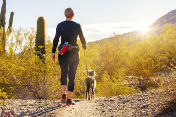 Woman Hiking With Dog in Phoenix Arizona