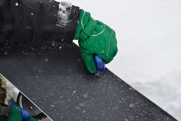 Waxing snowboard surface for better gliding during snowfall