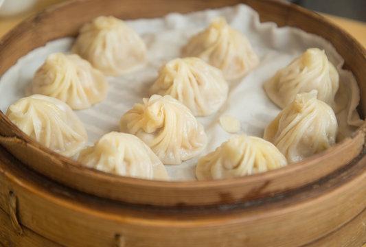Xiao Long Bao traditional soup dumpling Xiao Long Bao is a popular Chinese dim sum steamed in bamboo steamers.
