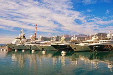 Line of yachts in the harbor. Montenegro, Tivat city, marina Porto Montenegro