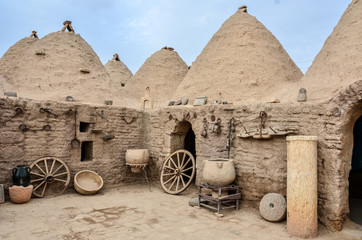 Fotobehang Midden Oosten Traditional beehive mud brick desert houses, located in Harran, Sanliurfa/Turkey. These buildings topped with domed roofs and constructed from mud and salvaged brick.