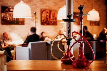 group of red hookahs shisha on table in interior