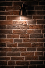 Brick wall with a lamp