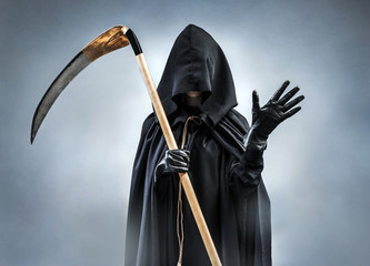 Grim Reaper welcomes you. Photo of silhouette grim reaper waving hand. Greeting gesture. Death