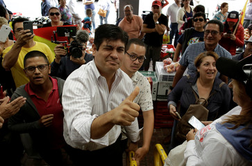 Carlos Alvarado Quesada, presidential candidate of the ruling Citizens' Action Party, visits a market before a second-round presidential election run-off in Cartago