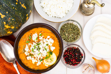 Pumpkin cream soup with goat cheese