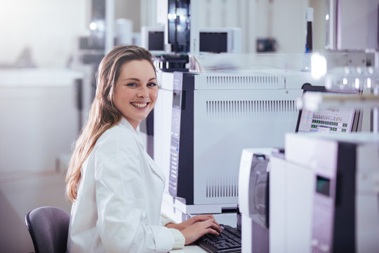 young woman scientist working with equipment in a laboratory