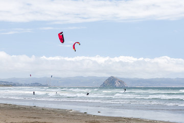 View of kite surfers from a beach, in Estero Bluffs State Park, California