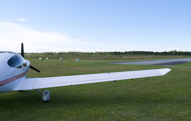Aviation: Modern four-seat airplane on the main apron of a small airfield in Denmark